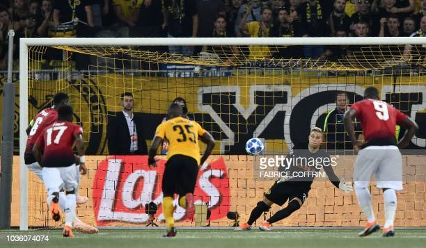 Manchester United's French midfielder Paul Pogba scores a penalty past Young Boys Swiss goalkeeper David von Ballmoos during the UEFA Champions...