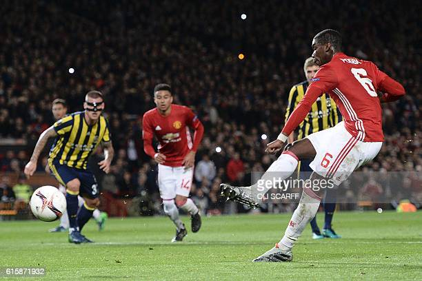 Manchester United's French midfielder Paul Pogba scores their first goal from the penalty spot during the UEFA Europa League group A football match...