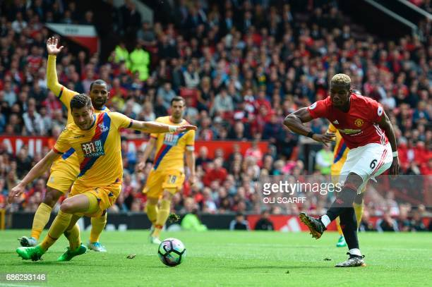 Manchester United's French midfielder Paul Pogba scores their second goal during the English Premier League football match between Manchester United...