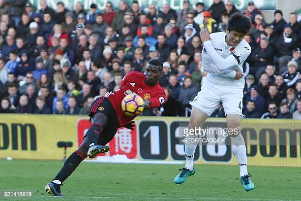 Manchester United's French midfielder Paul Pogba shoots to score his team's first goal during the English Premier League football match between...