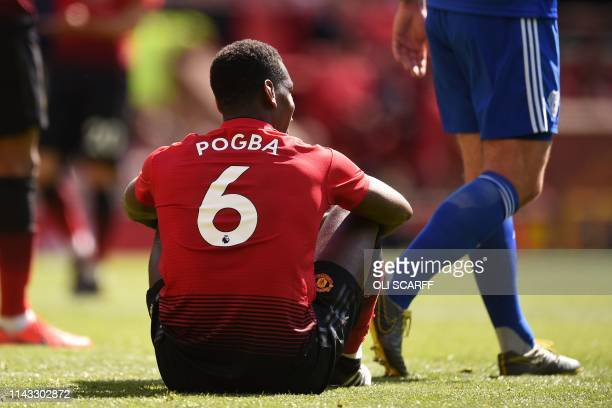 Manchester United's French midfielder Paul Pogba sits during the English Premier League football match between Manchester United and Cardiff City at...