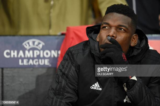 Manchester United's French midfielder Paul Pogba sits on the bench during the UEFA Champions League group H football match between Manchester United...
