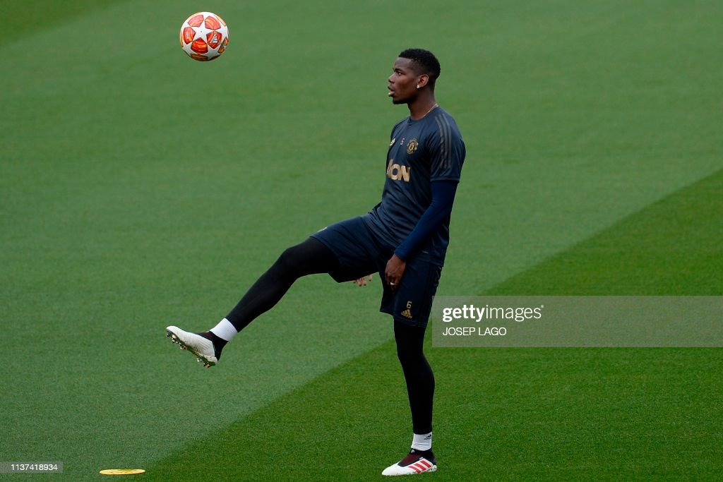 8a4b2d5107d Manchester United s French midfielder Paul Pogba takes part in a ...