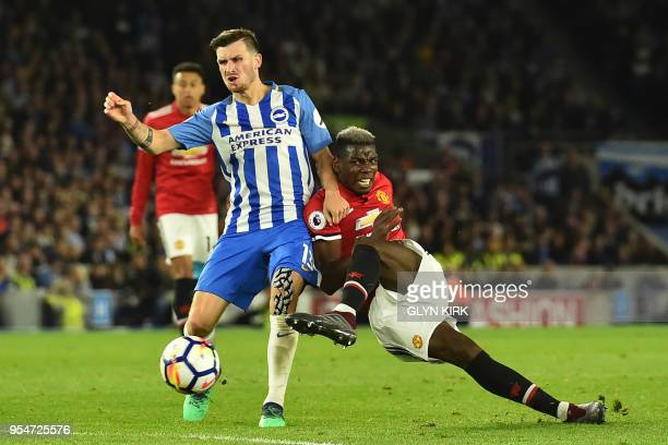 TOPSHOT Manchester United's French midfielder Paul Pogba tries to get a shot away under pressure from Brighton's German midfielder Pascal Gross...