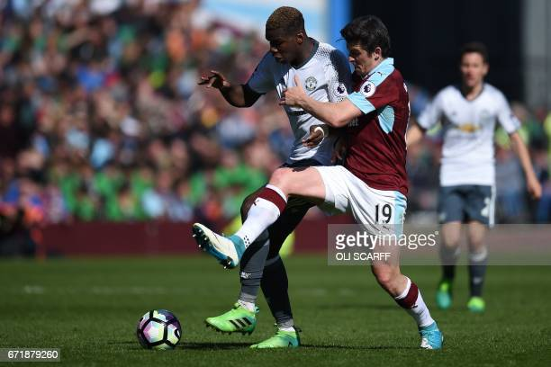 Manchester United's French midfielder Paul Pogba vies for the ball with Burnley's English midfielder Joey Barton during the English Premier League...