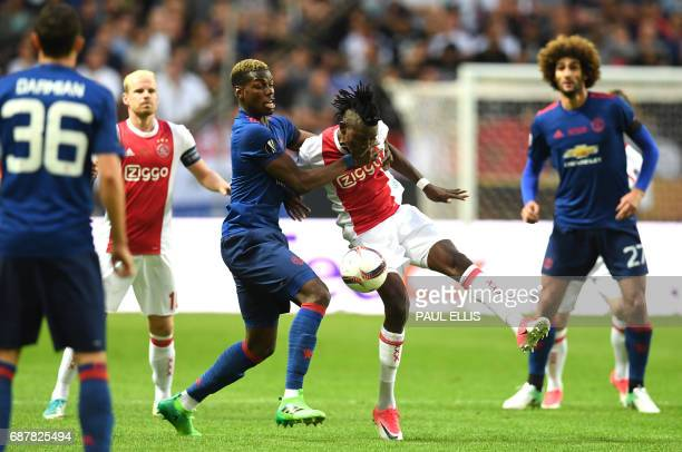Manchester United's French midfielder Paul Pogba vies with Ajax Burkinabe forward Bertrand Traoré for the ball during the UEFA Europa League final...