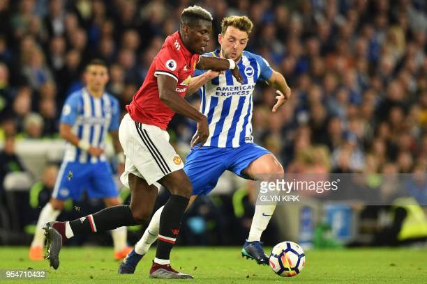 Manchester United's French midfielder Paul Pogba vies with Brighton's English midfielder Dale Stephens during the English Premier League football...