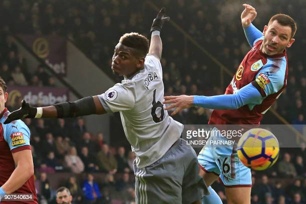 Manchester United's French midfielder Paul Pogba vies with Burnley's Englishborn Scottish defender Phil Bardsley during the English Premier League...