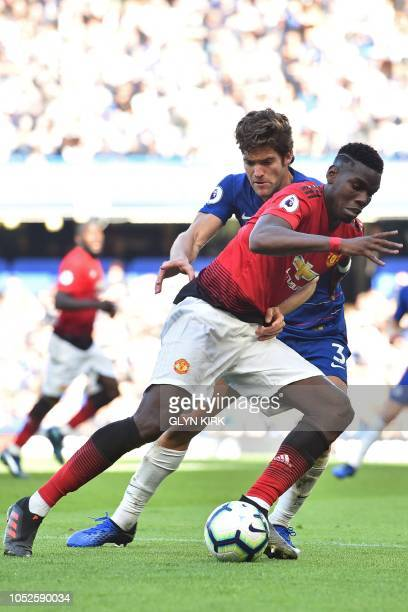 Manchester United's French midfielder Paul Pogba vies with Chelsea's Spanish defender Marcos Alonso during the English Premier League football match...