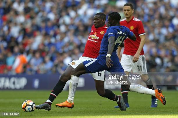 Manchester United's French midfielder Paul Pogba vies with Chelsea's French midfielder Tiemoue Bakayoko during the English FA Cup final football...