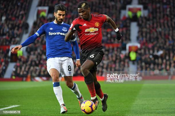 Manchester United's French midfielder Paul Pogba vies with Everton's Portuguese midfielder André Gomes during the English Premier League football...