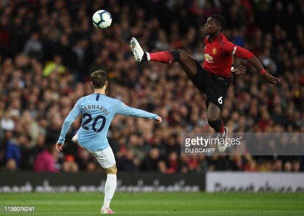 TOPSHOT Manchester United's French midfielder Paul Pogba vies with Manchester City's Portuguese midfielder Bernardo Silva during the English Premier...