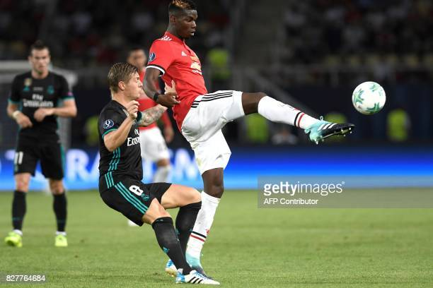 Manchester United's French midfielder Paul Pogba vies with Real Madrid's German midfielder Toni Kroos during the UEFA Super Cup football match...