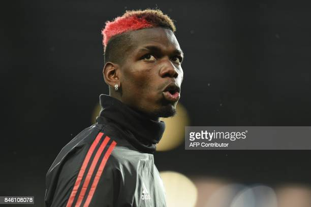 Manchester United's French midfielder Paul Pogba warms up ahead of the UEFA Champions League Group A football match between Manchester United and...