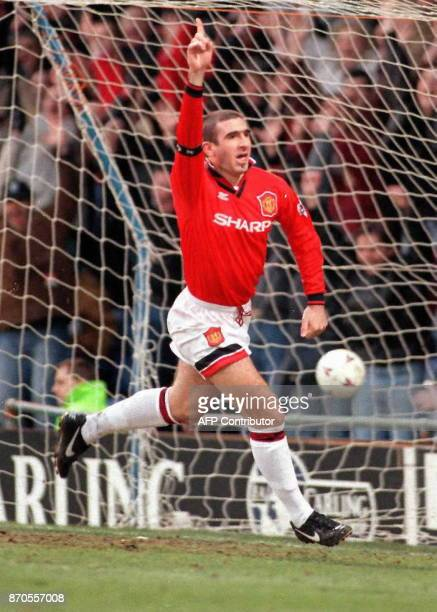 Manchester United's French star Eric Cantona celebrates a goal at Selhurst Park 03 February during United's Premiership match against Wimbledon in...