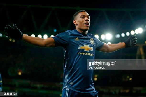 Manchester United's French striker Anthony Martial celebrates after scoring their third goal during the English FA Cup fourth round football match...