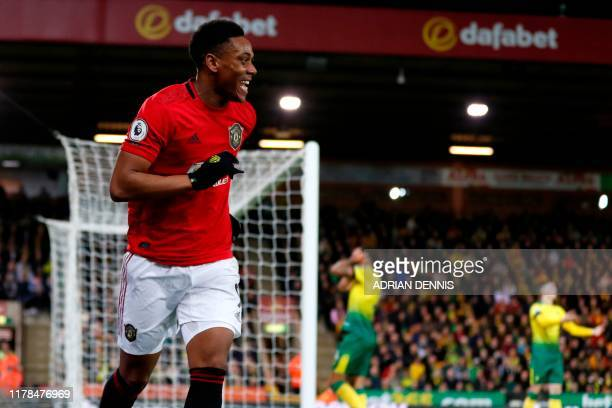 Manchester United's French striker Anthony Martial celebrates after scoring their third goal during the English Premier League football match between...