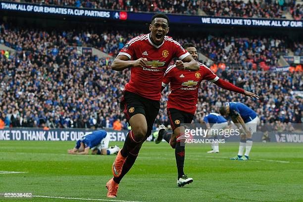 Manchester United's French striker Anthony Martial celebrates after scoring their second goal during the English FA Cup semifinal football match...