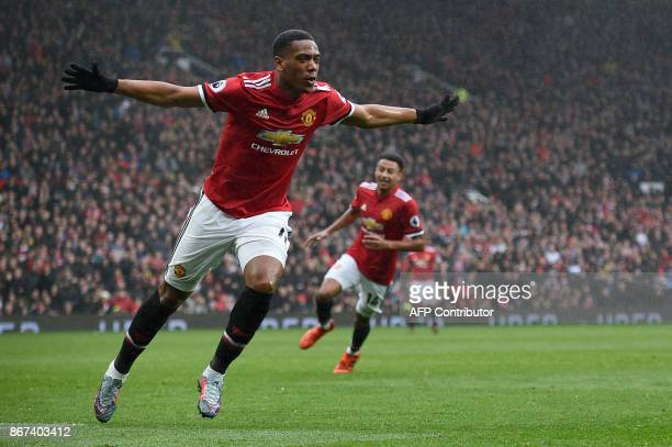 Manchester United's French striker Anthony Martial celebrates after scoring the opening goal of the English Premier League football match between...