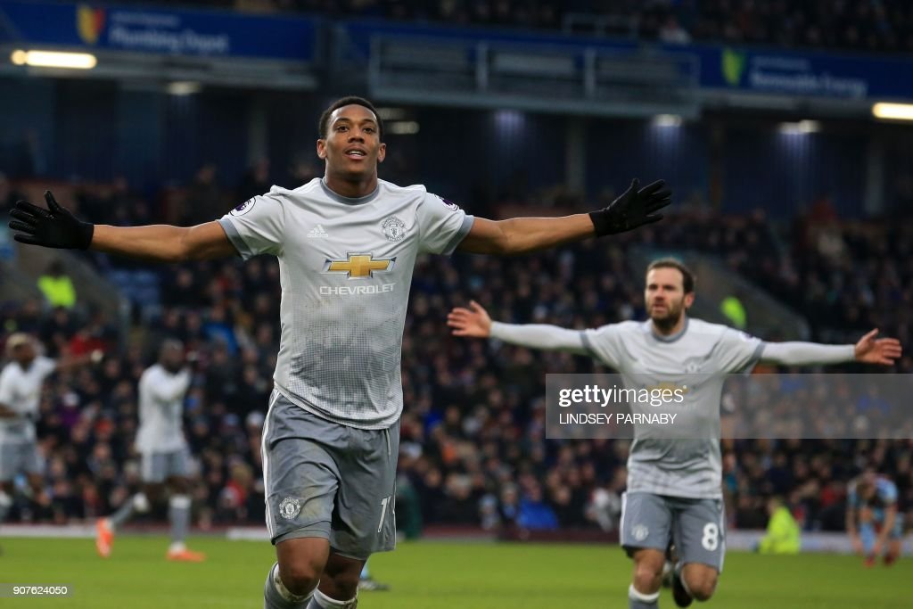 Manchester United's French striker Anthony Martial (L) celebrates after scoring the opening goal of the English Premier League football match between Burnley and Manchester United at Turf Moor in Burnley, north west England on January 20, 2018. / AFP PHOTO / Lindsey PARNABY / RESTRICTED TO EDITORIAL USE. No use with unauthorized audio, video, data, fixture lists, club/league logos or 'live' services. Online in-match use limited to 75 images, no video emulation. No use in betting, games or single club/league/player publications. /