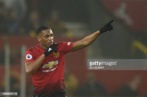 Manchester United's French striker Anthony Martial celebrates scoring their first goal to equalise 11 during the English Premier League football...
