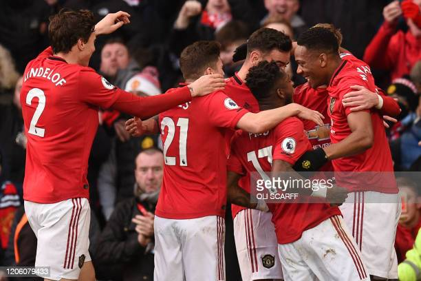 Manchester United's French striker Anthony Martial celebrates scoring his team's first goal during the English Premier League football match between...