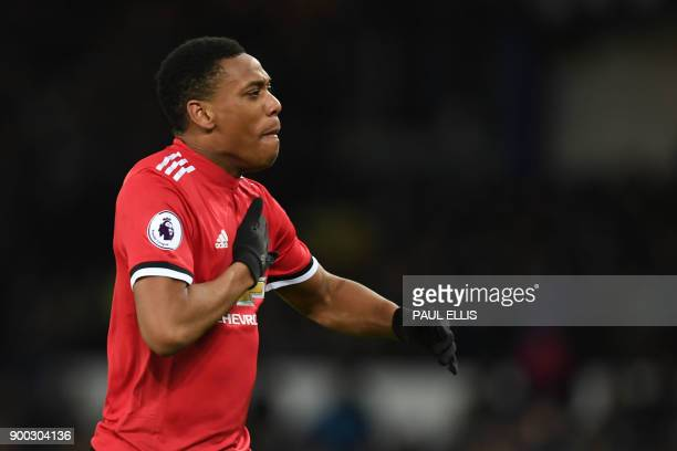 Manchester United's French striker Anthony Martial celebrates scoring the team's first goal during the English Premier League football match between...