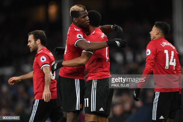 Manchester United's French striker Anthony Martial celebrates scoring the team's first goal with Manchester United's French midfielder Paul Pogba...