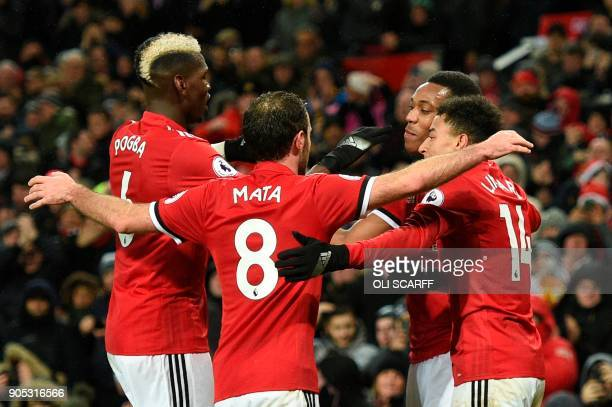 Manchester United's French striker Anthony Martial celebrates scoring their second goal with Manchester United's French midfielder Paul Pogba...
