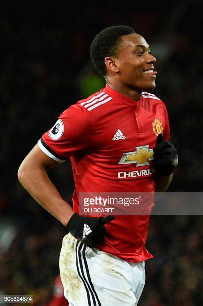 Manchester United's French striker Anthony Martial celebrates scoring their second goal during the English Premier League football match between...