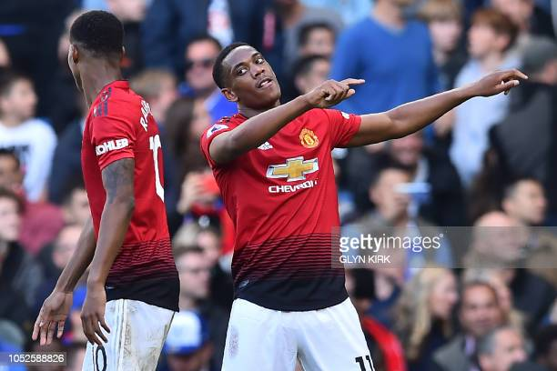 Manchester United's French striker Anthony Martial celebrates with Manchester United's English striker Marcus Rashford after scoring their second...