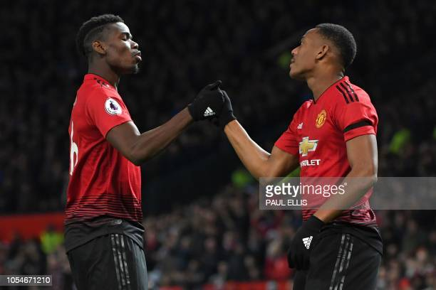 Manchester United's French striker Anthony Martial celebrates with Manchester United's French midfielder Paul Pogba after scoring their second goal...