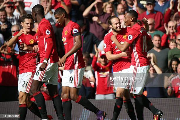 Manchester United's French striker Anthony Martial celebrates with Manchester United's Dutch midfielder Daley Blind after scoring the opening goal of...