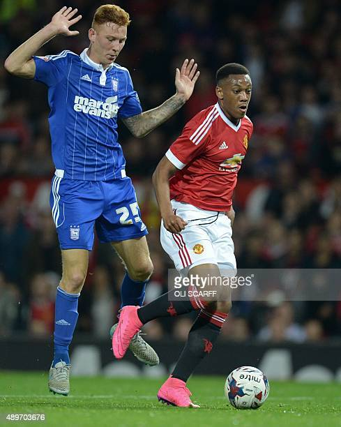 Manchester United's French striker Anthony Martial controls the ball ahead of Ipswich Town's Welsh defender Josh Yorwerth before scoring his team's...