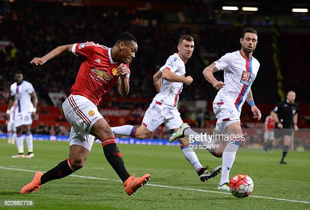 Manchester United's French striker Anthony Martial crosses the ball during the English Premier League football match between Manchester United and...