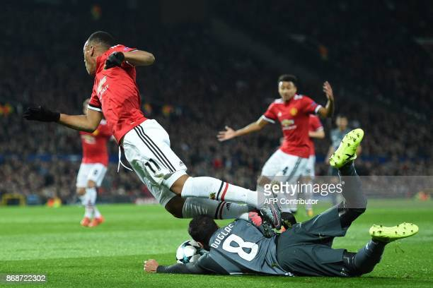 Manchester United's French striker Anthony Martial goes down in the area fouled by Benfica's Brazilian defender Douglas Pereira dos Santos for a...