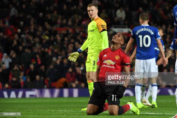 Manchester United's French striker Anthony Martial reacts after missing a chance saved by Everton's English goalkeeper Jordan Pickford during the...