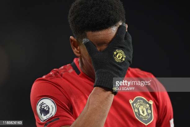 Manchester United's French striker Anthony Martial reacts as he is substituted during the English Premier League football match between Manchester...