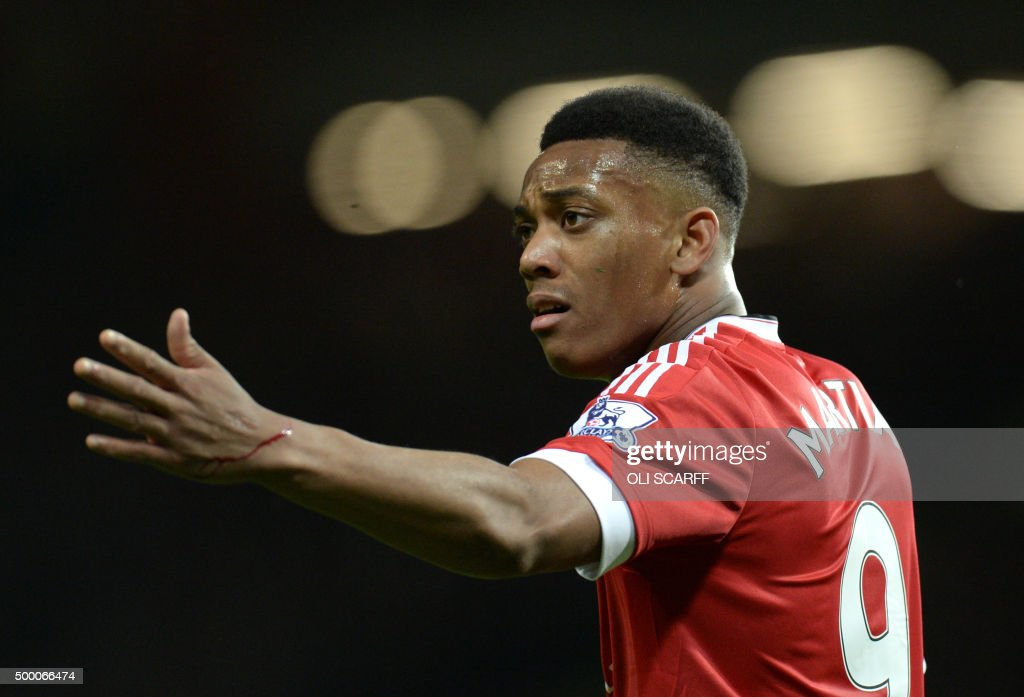 Manchester United's French striker Anthony Martial reacts during the English Premier League football match between Manchester United and West Ham United at Old Trafford in Manchester, north west England, on December 5, 2015. AFP PHOTO / OLI SCARFF USE. No use with unauthorized audio, video, data, fixture lists, club/league logos or 'live' services. Online in-match use limited to 75 images, no video emulation. No use in betting, games or single club/league/player publications. /