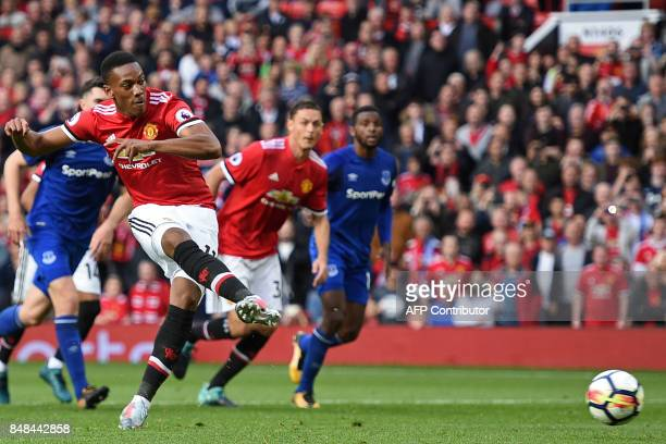 Manchester United's French striker Anthony Martial scores their fourth goal from the penalty spot during the English Premier League football match...