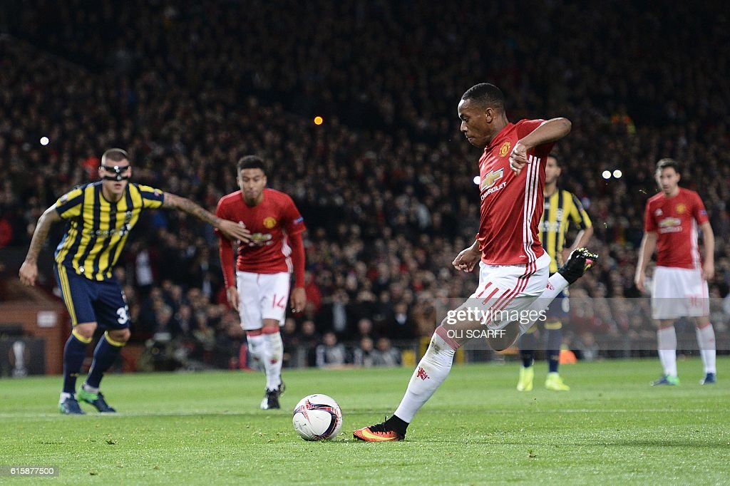 Manchester United's French striker Anthony Martial scores their second goal from the penalty spot during the UEFA Europa League group A football match between Manchester United and Fenerbahce at Old Trafford in Manchester, north west England, on October 20, 2016. / AFP / OLI