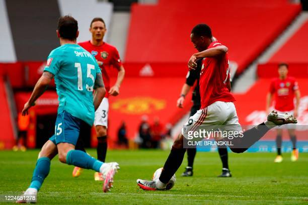 Manchester United's French striker Anthony Martial shoots and scores a goal during the English Premier League football match between Manchester...