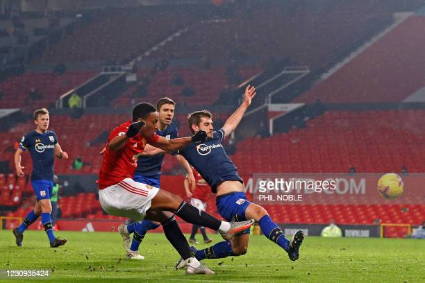 Manchester United's French striker Anthony Martial shoots to score their fifth goal during the English Premier League football match between...