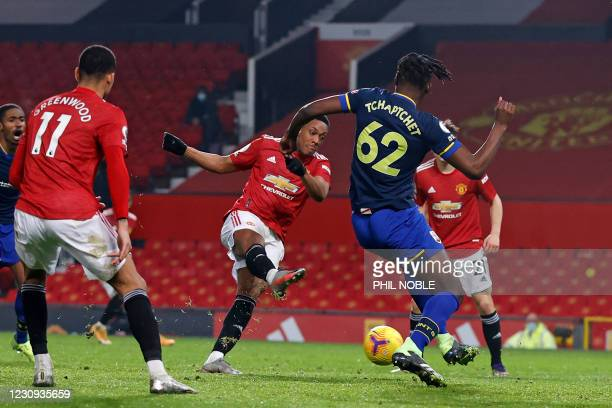 Manchester United's French striker Anthony Martial shoots to score their eighth goal during the English Premier League football match between...
