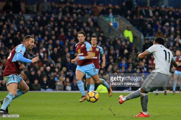 Manchester United's French striker Anthony Martial shoots to score the opening goal past Burnley's Englishborn Scottish defender Phil Bardsley during...