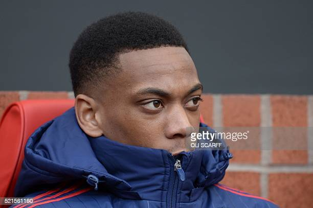 Manchester United's French striker Anthony Martial sits on the substitutes bench during the English Premier League football match between Manchester...