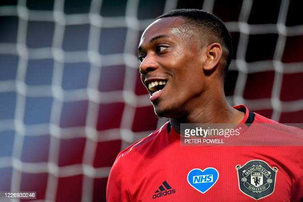 Manchester United's French striker Anthony Martial smiles during the English Premier League football match between Manchester United and Southampton...