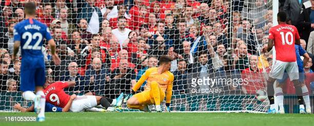 Manchester United's French striker Anthony Martial turns to celebrate after scoring their second goal past Chelsea's Spanish goalkeeper Kepa...