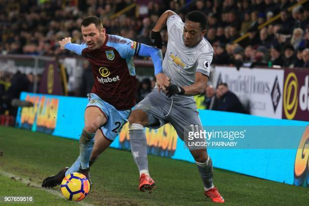 Manchester United's French striker Anthony Martial vies with Burnley's Englishborn Scottish defender Phil Bardsley during the English Premier League...