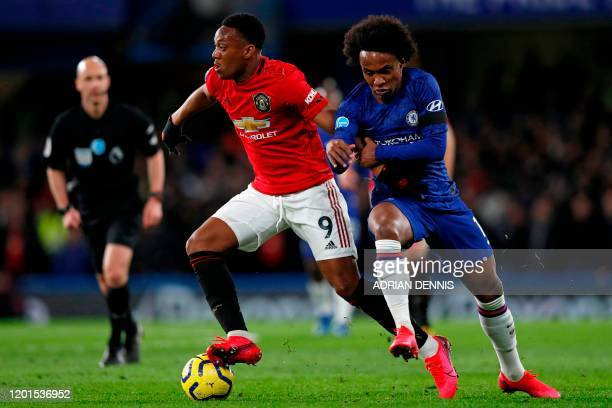 Manchester United's French striker Anthony Martial vies with Chelsea's Brazilian midfielder Willian during the English Premier League football match...